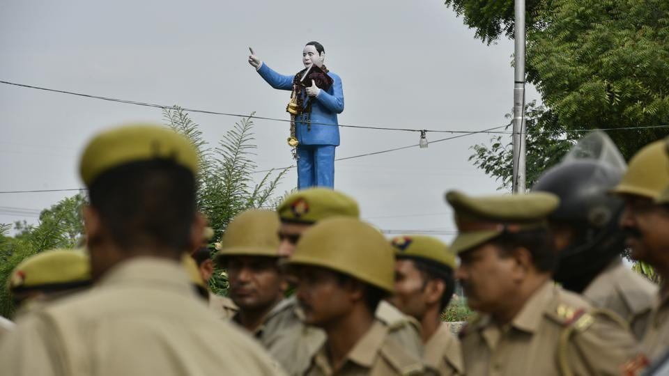 Police personnel prepare for an inspection of the procession's route a day prior. In a village where the Thakurs outnumber Dalits 9:1, their word was law. Not this time, though. Launching with a petition to the local police station in February, Jatav's fight for an equal wedding became as important for Nizampur as for the nation at a time when caste conflicts seem to have turned on their axis. (Anushree Fadnavis / HT Photo)