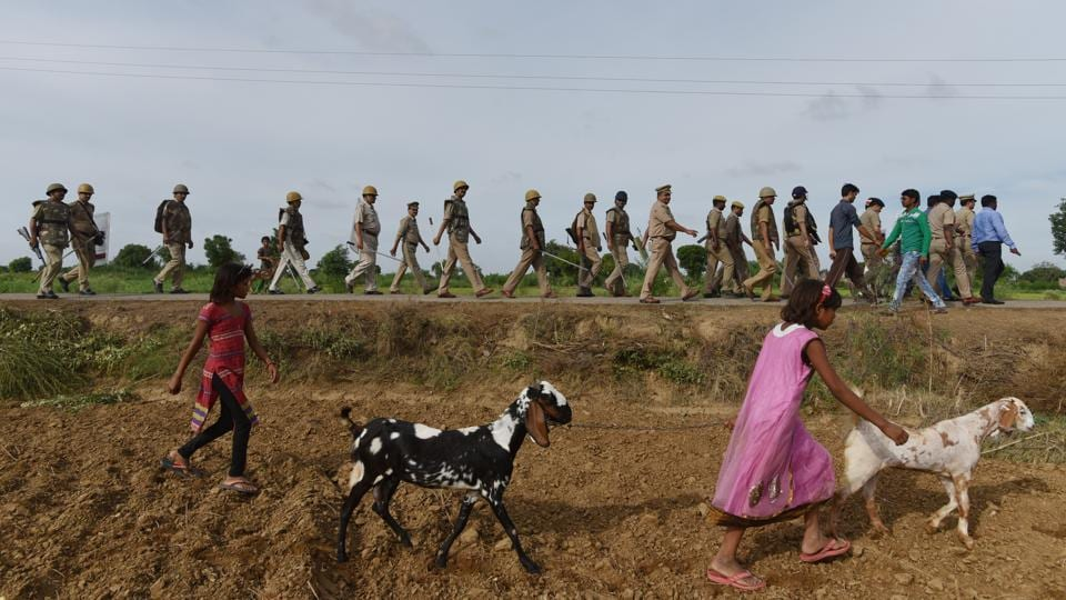 Police personnel inspect an area in the fields where a tent was being erected for the procession. At the negotiation in April, Thakurs refused to give in to Jatav's demand to ride a horse around the village. So, the officials drew up an alternate route for the baraat that cut halfway through Nizampur. Everyone agreed to it, at last. (Anushree Fadnavis / HT Photo)