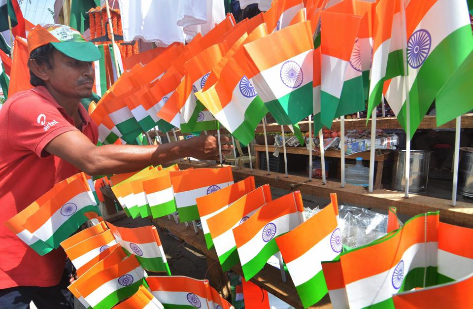 A vendor sells Tricolours ahead of the Independence Day function, in Guwahati on Saturday.