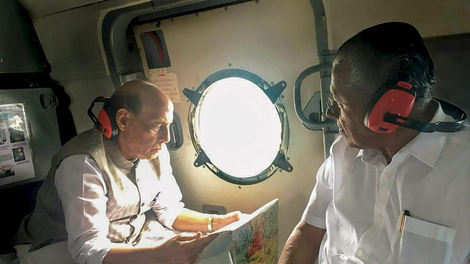 Union home minister Rajnath Singh with Kerala chief minister Pinarayi Vijayan conduct an aerial survey of flood-affected areas of Kerala on Sunday.