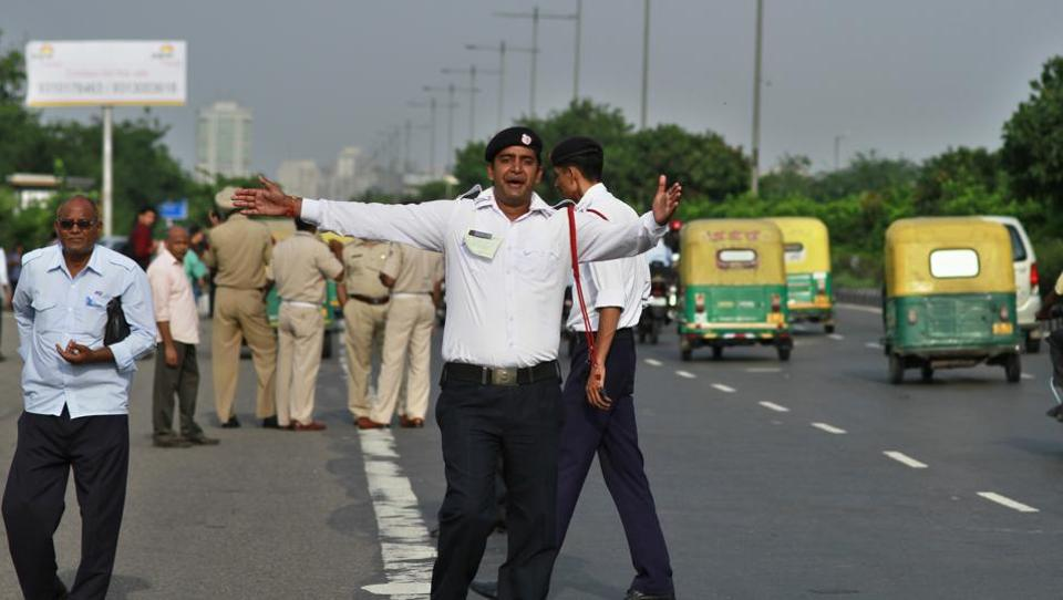 A traffic policeman regulates traffic ahead of the Independence Day parade in New Delhi on Wednesday.