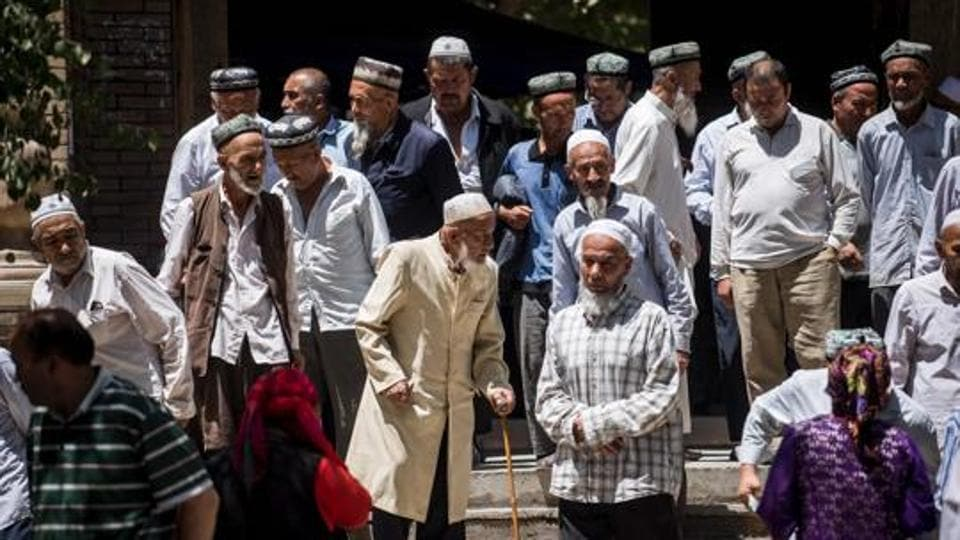 Local Muslims leaving a Mosque after Friday prayers in Hotan, in China's Xinjiang Uighur Autonomus Region on June 23, 2017.