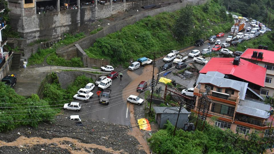 Vehicles buried under the debris after heavy rainfall triggered a landslide on ISBT-Dhalli bypass, Shimla, on Monday.