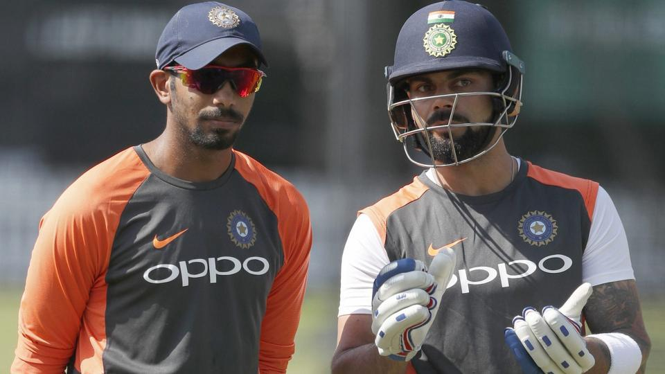 Jasprit Bumrah, left, speaks to his captain Virat Kohli during a training session at Lord's Cricket ground in London.