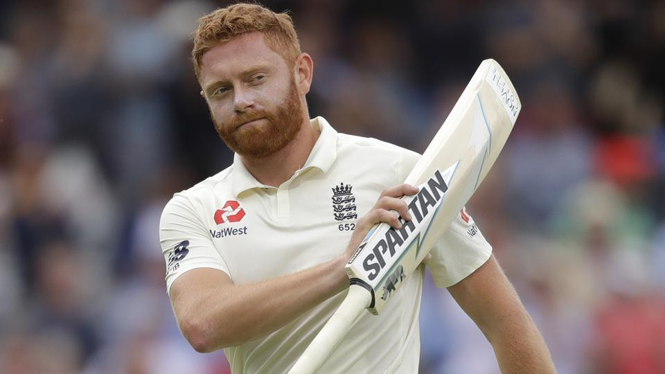 England's Jonny Bairstow holds up his bat to applause as he leaves the pitch after he is caught by India's Dinesh Karthik during the third day of the second test match between England and India at Lord's.