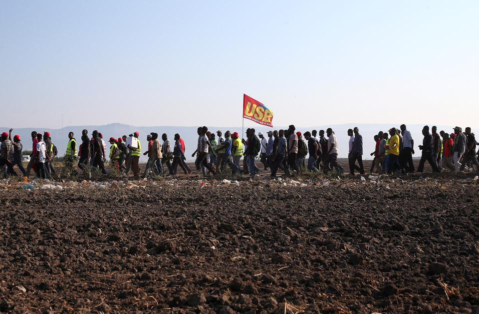 African migrant labourers stage a march to protest against their work conditions, following the death of 16 of their colleagues in two separate road accidents near Foggia, Italy. The tragedies have brought into focus the dire working and living conditions imposed on thousands of migrant farmhands whose cut-price labour allows Italy to be one of the biggest fruit and vegetable exporters in Europe. (Alessandro Bianchi / REUTERS)