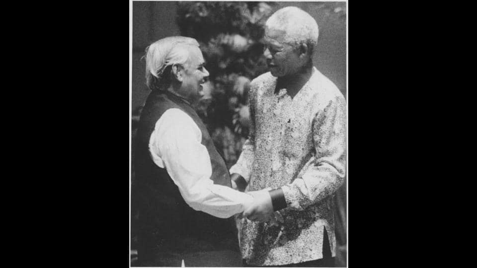 Atal Bihari Vajpayee being received by Nelson Mandela on his arrival in Durban to attend the inauguration of the 12th NAM Summit on September 2, 1998. (HT Archive)