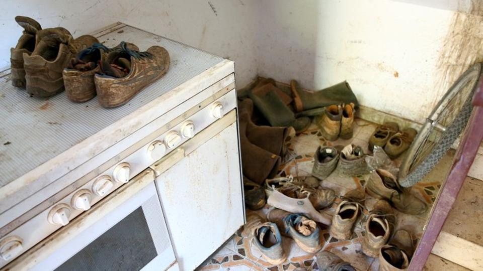 "African migrant labourers' shoes are seen in a shelter near Foggia. Ludovico Vaccaro, the magistrate investigating the August 6 deaths, says rampant exploitation of foreign labourers has gone largely unchecked for years. ""They should rebel, but they are so poor they have to accept the unacceptable,"" he told Reuters. (Alessandro Bianchi / REUTERS)"