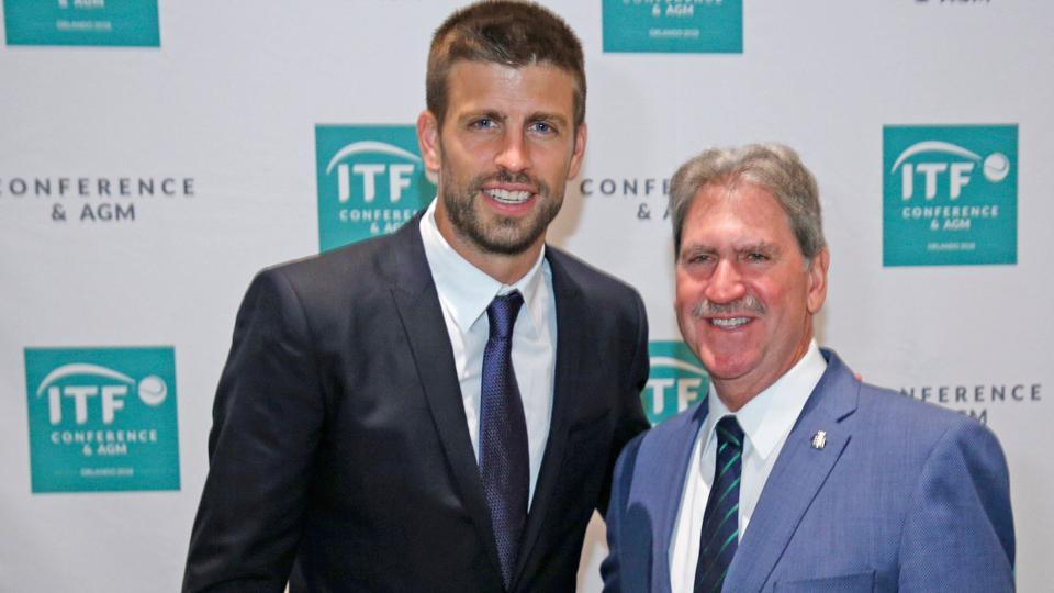 David Haggerty (R), President of the International Tennis Federation poses with with Gerard Pique, Founder of Kosmos sports group during the ITF annual general meeting in Orlando, Florida.