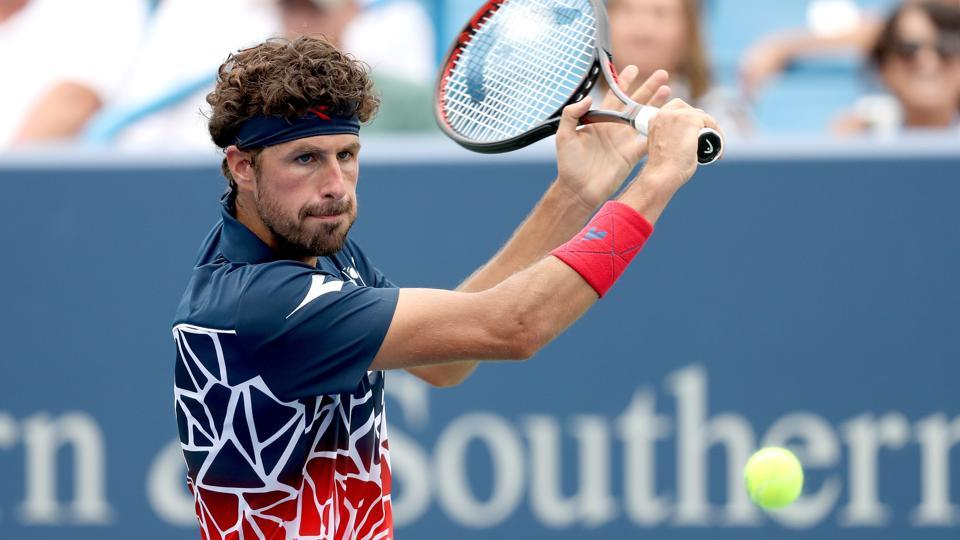 Robin Haase of Netherlands returns a shot to Alexander Zverev of Germany during the Western & Southern Open at Lindner Family Tennis Center on August 15, 2018 in Mason, Ohio.
