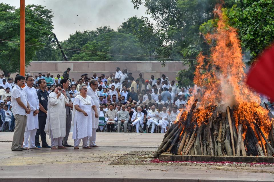 Family members and relatives of former PM Atal Bihari Vajpayee during his cremation at Rashtriya Smriti Sthal in New Delhi on Friday.