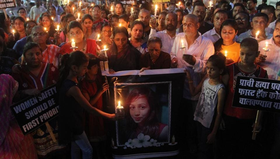 Residents take part in the candlelight march on Thursday. They marched from Kopri Bara Bungalow to Anand talkies.