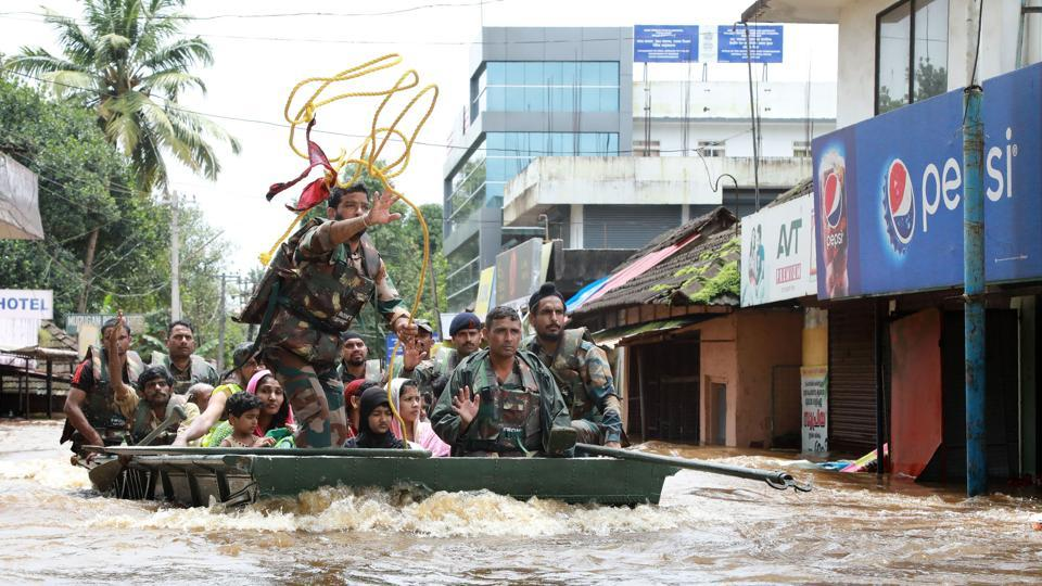 Indian army personal evacuate local residents in a residential area at Aluva in Ernakulam district, in Kerala, on August 17, 2018.