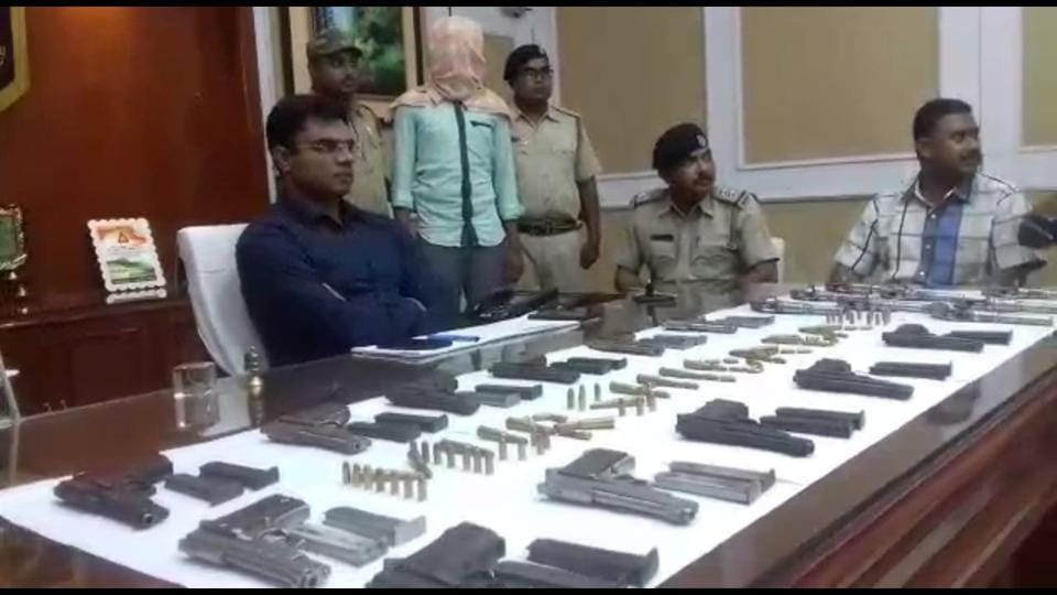 Murshidabad police superintendent of police Mukesh (in blue shirt) with the seized firearms on Saturday.