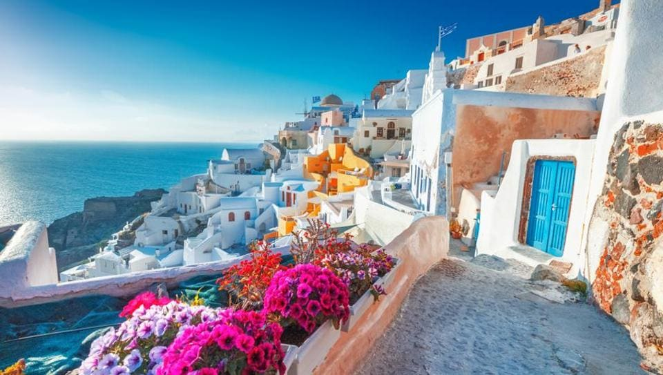 Santorini, Greece: With its cobbled streets, blue churches, whitewashed houses and glorious sunsets, Santorini is one of the most Instagrammable places ever.  (Shutterstock)