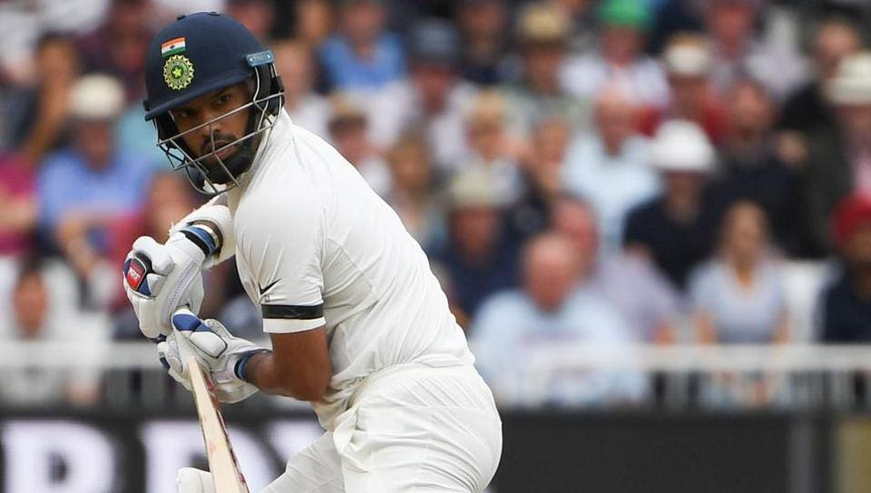 India's Shikhar Dhawan plays a shot during the first day of the third Test cricket match between England and India at Trent Bridge in Nottingham, central England on August 18, 2018.