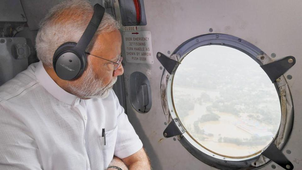 Prime Minister Narendra Modi conducts an aerial survey of flood-affected areas in Kerala on Saturday, August 18, 2018.