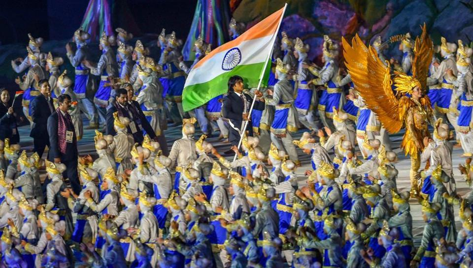 Star javelin thrower Neeraj Chopra bears the tricolour as he leads the Indian contingent at Gelora Bung Karno during the opening ceremony of Asian Games 2018, in Jakarta on Saturday, August 18, 2018.