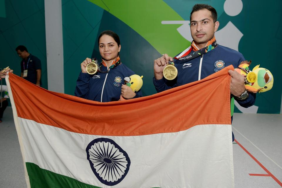 Palembang: Indian shooters Ravi Kumar and Apurvi Singh Chandela celebrate after winning the bronze medal in the Final 10m Air Rifle Mix Team event during the 18th Asian Games Jakarta Palembang, in Indonesia on Sunday, Aug 19, 2018. (PTI Photo/Vijay Verma) (PTI8_19_2018_000049B) (PTI)