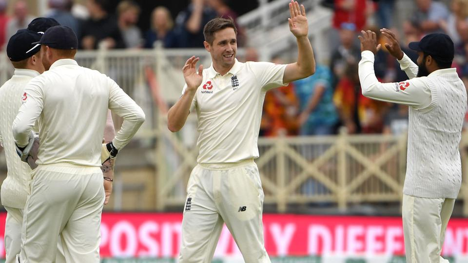 England's Chris Woakes (C) celebrates with teammates after taking the wicket of India's Shikhar Dhawan for 35. (AFP)