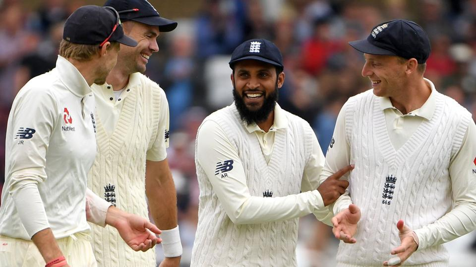 England's Adil Rashid (C) smiles as he celebrates catching out India's Cheteshwar Pujara during play on the first day. (AFP)