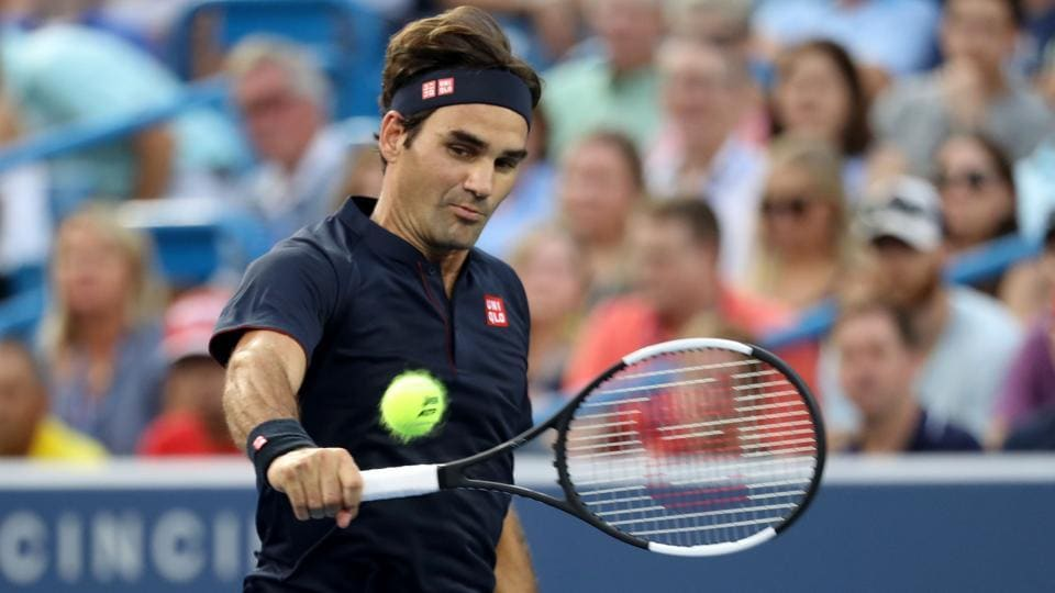 Roger Federer of Switzerland returns a shot to David Goffin of Belgium at the Cincinnati Masters.