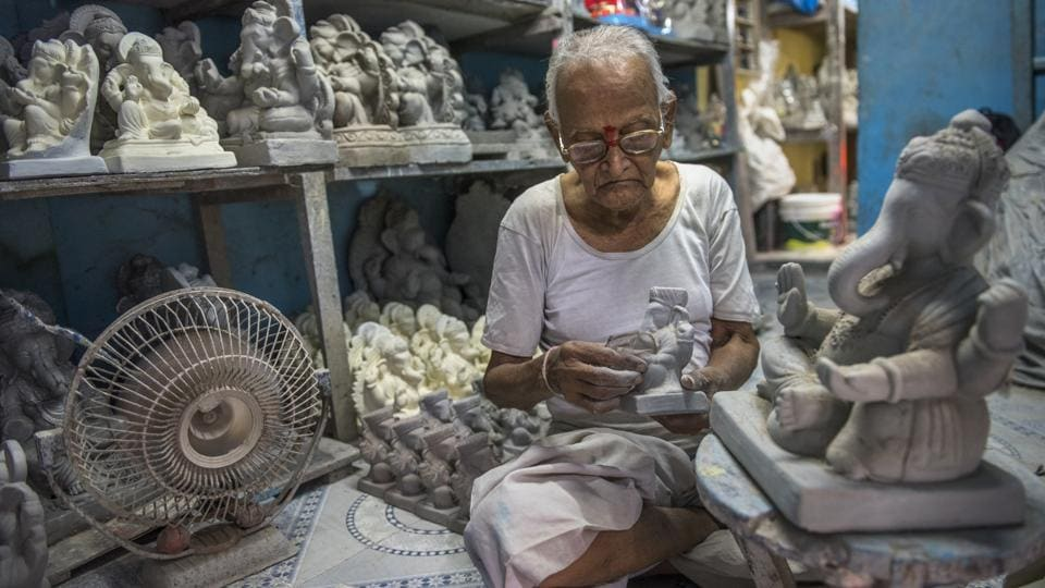 Eighty-five-year-old sculptor Pandurang Hazare has been making clay idols at his family workshop in the town of Pen, Raigad district, Maharashtra for the last 70 years. With less than a month to go for Ganesh Chaturthi, civic authorities are focusing on implementing a ban on plaster of Paris (PoP) idols. But for Hazare, idols that don't pollute have been a priority from the get go. (Satish Bate / HT Photo)