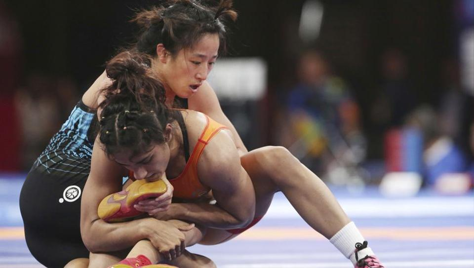 China's Sun Yanan, left, and India's Vinesh Vinesh compete during the woman's freestyle 50 kg wrestling at the 18th Asian Games in Jakarta, Indonesia, Monday, Aug. 20, 2018.