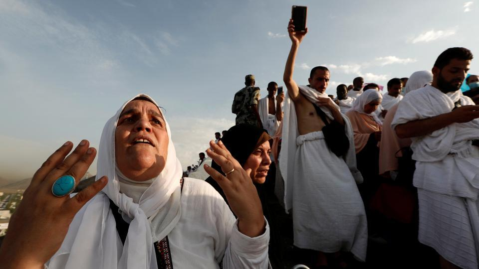 A Muslim pilgrim prays as she gather with others on Mount Mercy (Jabal ar-Rahmah) on the plains of Arafat during the annual Hajj pilgrimage on August 20, 2018. Muslims believe prayer on Mount Arafat, about 20 kilometers east of the holy city of Mecca, is their best chance to erase past sins and start anew. (Zohra Bensemra / REUTERS)