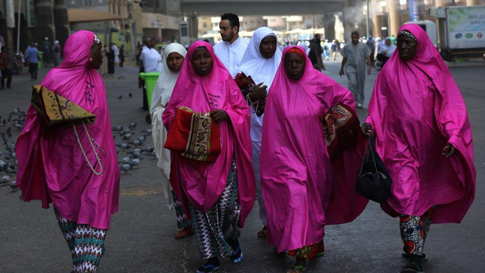 African pilgrims walk outside the Grand Mosque in Mecca, prior to the start of the annual Hajj pilgrimage. The ultra-conservative kingdom -- where religion remains a guiding force amid dramatic social and economic reforms -- has mobilised vast resources for the five-day journey, a pillar of Islam. (Ahmad Al-Rubaye / AFP)