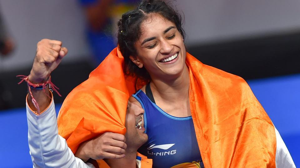 Vinesh Phogat celebrates after winning the Gold medal in women's freestyle 50 kg wrestling at the Asian Games 2018.