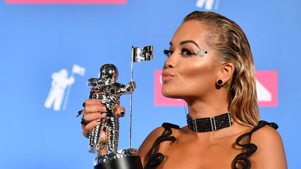 British singer Rita Ora poses with her award for Best Dance.   (AFP)