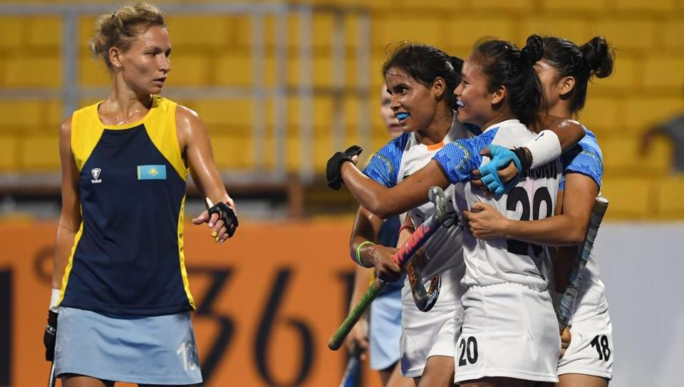 India players celebrate after scoring a goal during the women's hockey pool B match between India and Kazakhstan at the 2018 Asian Games in Jakarta on August 21, 2018.