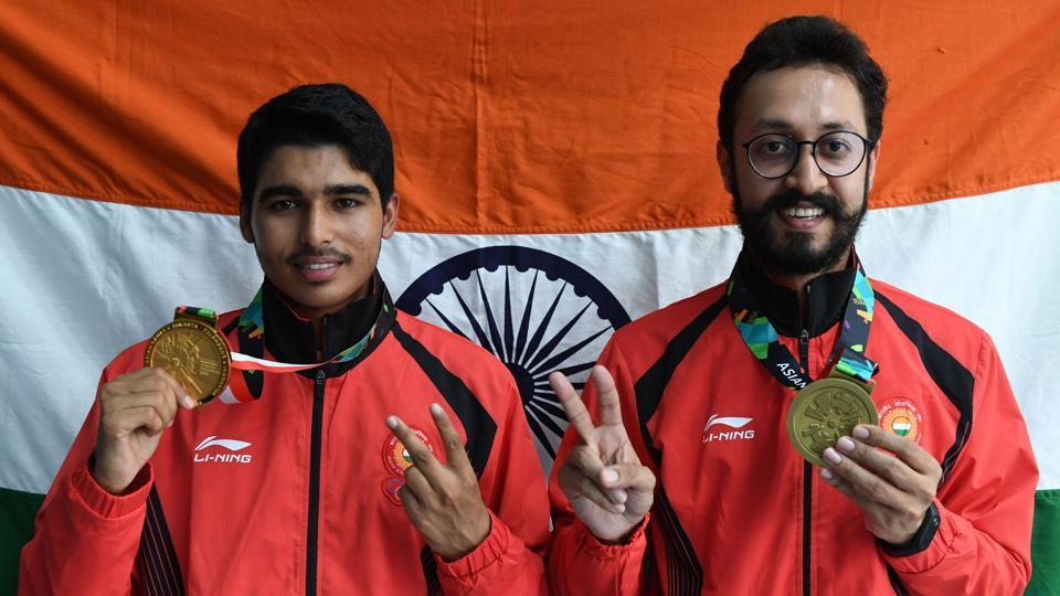 Gold medallist India's Saurabh Chaudhary (L) and bronze medallist India's Abhishek Verma pose with their medals after their victory ceremony for the 10m air pistol men's shooting final during the 2018 Asian Games in Palembang on August 21, 2018.  (AFP)
