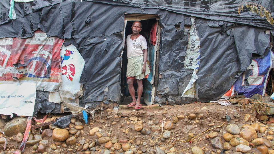 A man looks from his shanty in a flash-floods affected area of Kalka Colony in Jammu. (PTI)