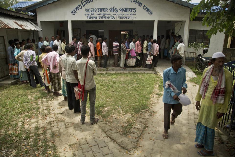 People whose name were left out in the NRC draft stand in a queue to collect forms to file appeals in Mayong, 45 kilometers east of Guwahati on August 10.
