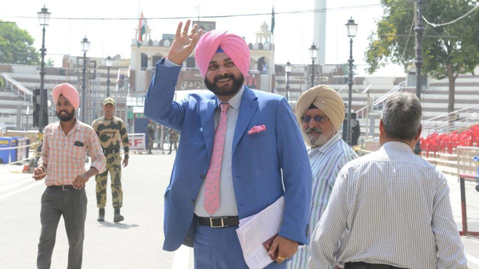 "Congress leader and Punjab minister Navjot Singh Sidhu, facing criticism for hugging Pakistan's army chief and visiting the country, said on Tuesday the gesture was made in an ""emotional moment"" and that his trip was not politically motivated. ""Pakistan army chief said they were making efforts to open corridor to Kartarpur Sahib, what followed was an emotional moment,"" Sidhu said. (Narinder Nanu / AFP File)"