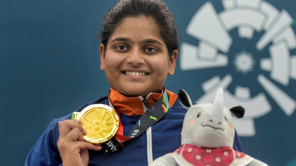 Gold medalist shooter Rahi Sarnobat poses for photographs after the presentation ceremony of women's 25m pistol event during the 18th Asian Games at Palembang. (PTI)