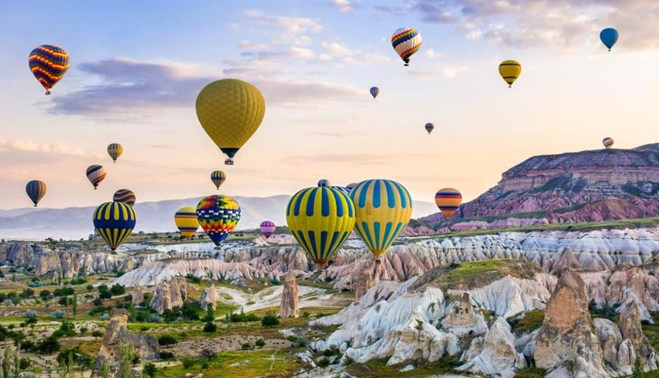 Cappadocia, Turkey: If you are on cloud nine, then it calls for a hot-air baloon proposal at Cappadocia. The ride is romantic and offers views of the region's fairy chimneys, hills and boulders.  (Shutterstock)