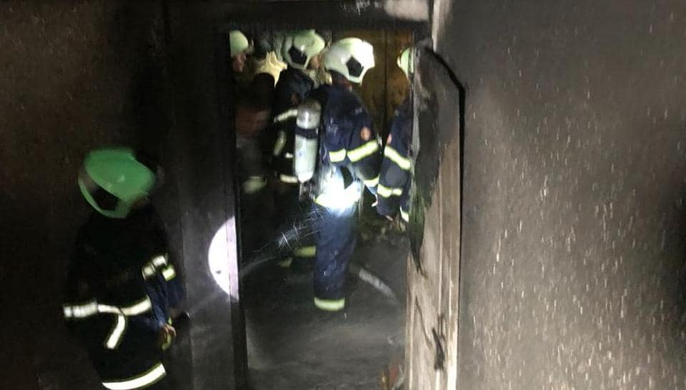Firemen inside the Crystal Tower residential apartment in Mumbai's Parel that caught fire on Wednesday.