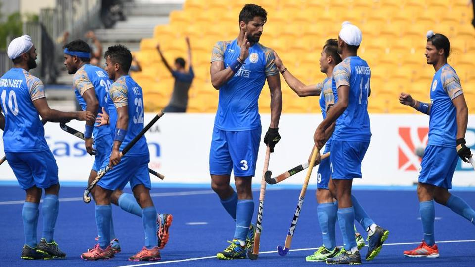 India's Rupinder Pal Singh (C) celebrates with teammates after scoring a goal during the men's hockey match against Hong Kong at the Asian Games 2018.