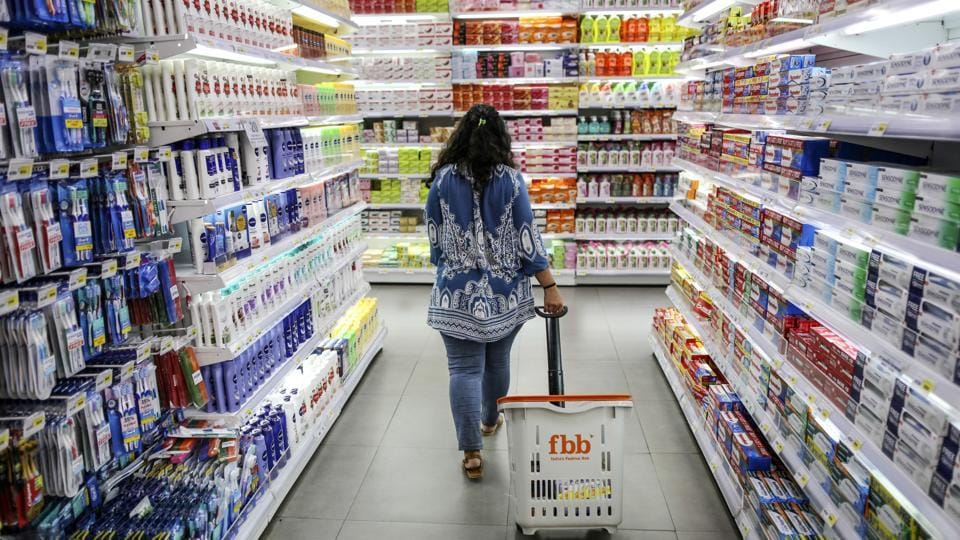A shopper walks through an aisle displaying personal care goods at a Big Bazaar hypermarket, operated by Future Retail Ltd., in Mumbai.