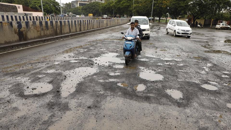 Continuous rainfall in the city for the past few days has led to potholes on a majority of roads. Commuters, especially two-wheeler riders, are finding it very difficult to drive on the roads.  Many are complaining of health issues as a result of bumpy rides.  (RAHUL RAUT/HT PHOTO)