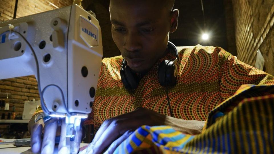 On a recent August day, 26-year-old Daouda Doumbia was carefully sewing the hem on a brightly coloured skirt for an American client. Doumbia said he fled ethnic tensions only to realize that the countries to which he had fled — Mali, Algeria and then Libya — were also dangerous. Undertaking the sea crossing in 2016, he received papers allowing him to work while he awaits a response on his asylum request. (Andrew Medichini / AP)