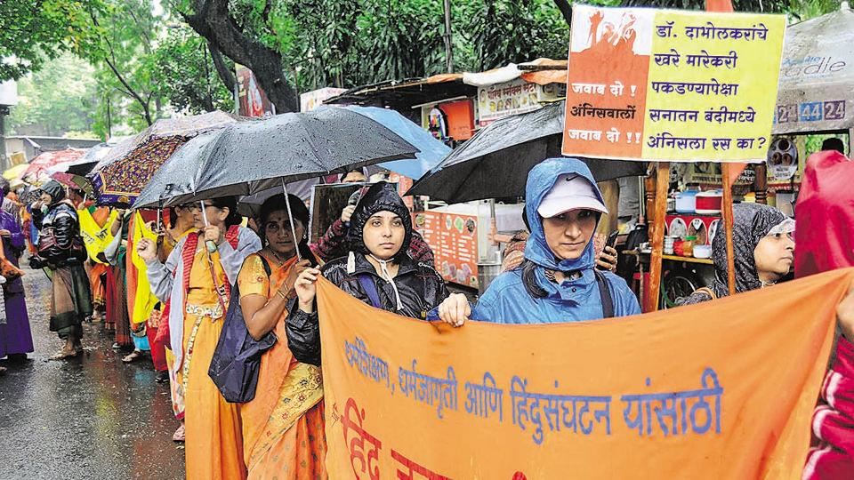 Hindu Janajagruti Samiti and Sanatan Sanstha members organised a march to protest the arrests made in the Narendra Dabholkar case. The march was held from Maharana Pratap garden to Kasba Ganpati temple on Tuesday. (RAVINDRA JOSHI/HT PHOTO)