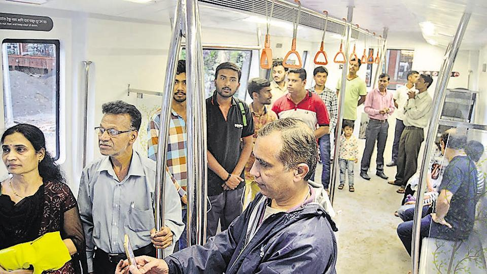 People visit the Metro information centre set up at Balgandharv Rang Mandir on Sunday. The information centre is a life-size model of Pune Metro coach, so that residents get a glimpse of how the metro coaches will look like when launched. (RAVINDRA JOSHI/HT PHOTO)