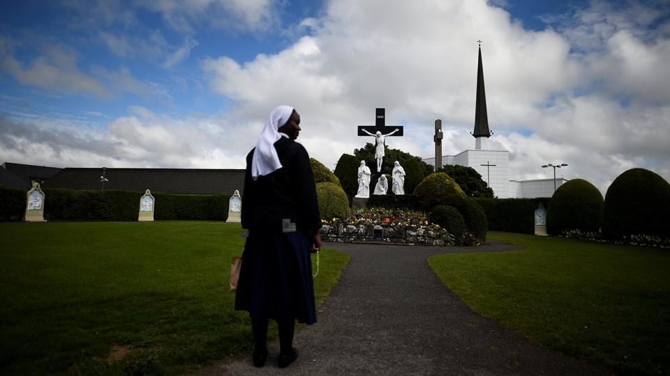 "A nun stands in front of a scene of the crucifix of Jesus in the Marian Shrine town of Knock. ""The church would have to change to accommodate younger people. Possibly, more than likely, they will have to ordain women priests because they have no priests at the moment to succeed the older priests that are here,"" said Tom Byrne. (Clodagh Kilcoyne / REUTERS)"