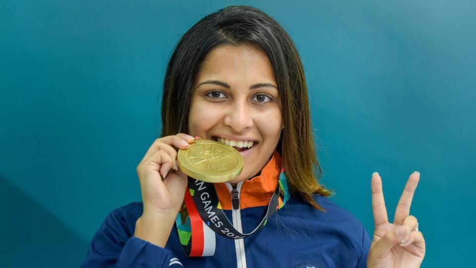 Palembang: Indian shooter Heena Sidhu poses for photo after winning bronze medal in the 10m Air Pistol. (PTI)