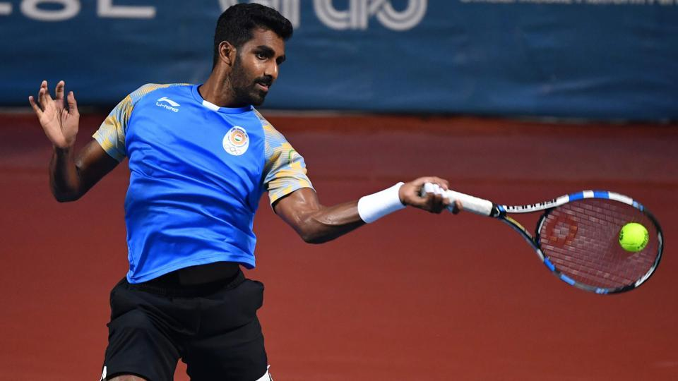 India's Prajnesh Gunneswaran plays a shot against Uzbekistan's Denis Istomin during their men's singles semi-final tennis match (AFP)