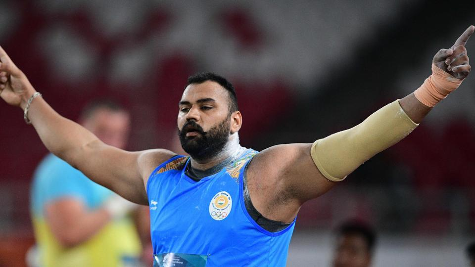 India's Tajinderpal Toor competes in the final of the men's shot put athletics event during the 2018 Asian Games in Jakarta on August 25, 2018.  (AFP)